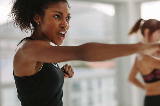 Women doing intense punching work out at the gym 939668892