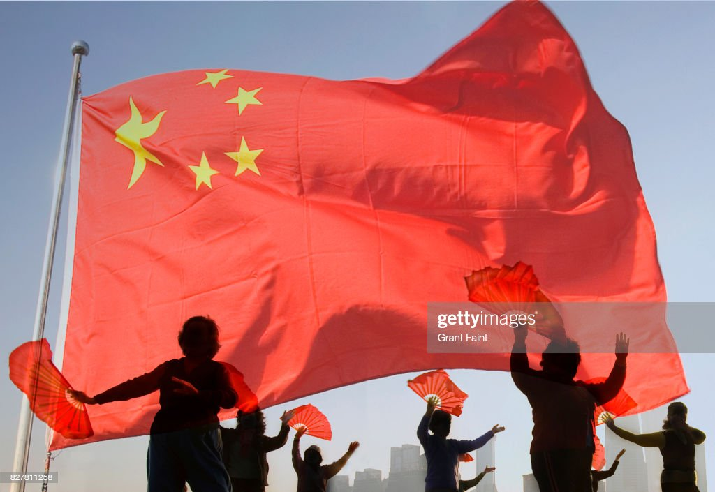 Women doing morning tai chi exercises with Chinese flag. : Stock Photo