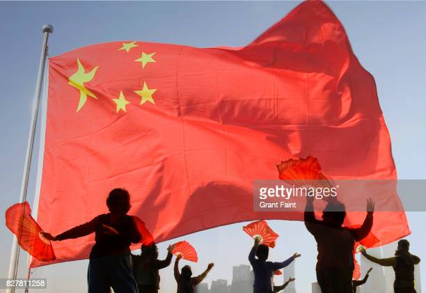 women doing morning tai chi exercises with chinese flag. - patriotism stock pictures, royalty-free photos & images