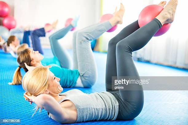 Women doing Pilates.