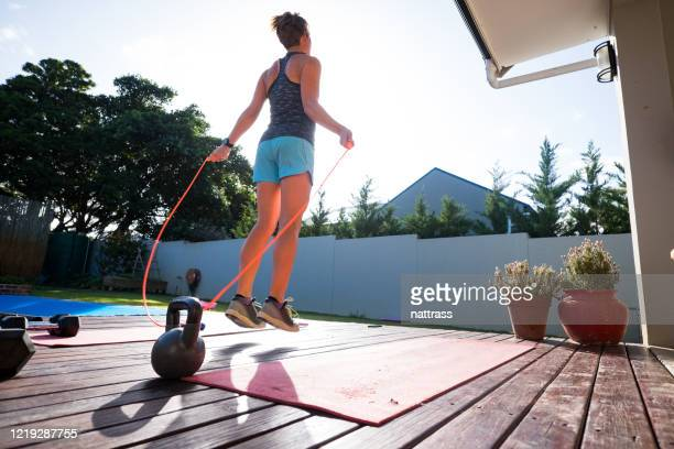 women doing some jump rope to keep fit at home - skipping along stock pictures, royalty-free photos & images