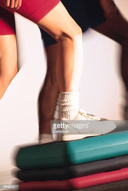Women doing step aerobics