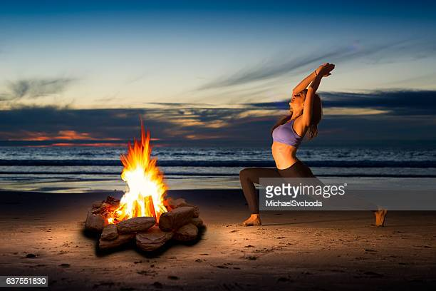 Women Doing Yoga By The Warmth Of A Fire