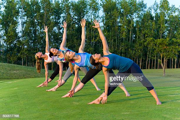 Women Doing Yoga in the Park