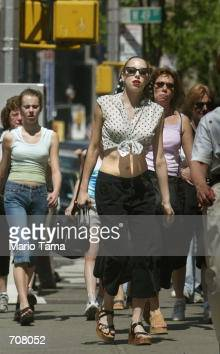 Women dress for the hot weather as they walk down Broadway April 17