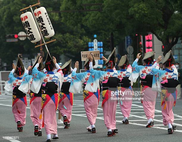 Women dress traditional in costume perform folk dance during the annual Himeji Castle Festival on August 3 2013 in Himeji Japan The parade of Castle...