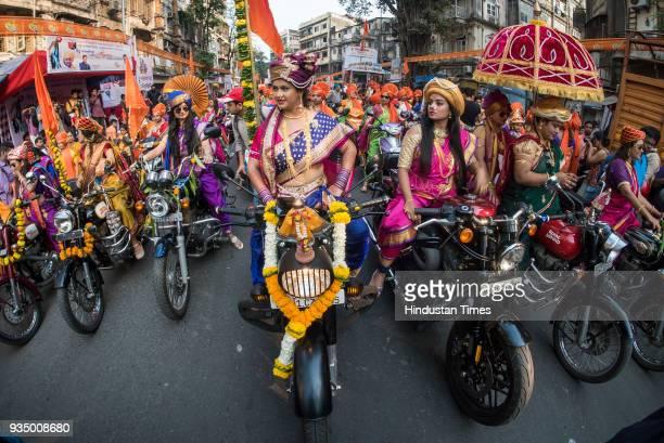 Women dress up in traditional Maharashtrian attire drive bikes during Gudi Padwa rally on their bikes at Girgaum on March 18 2018 in Mumbai India