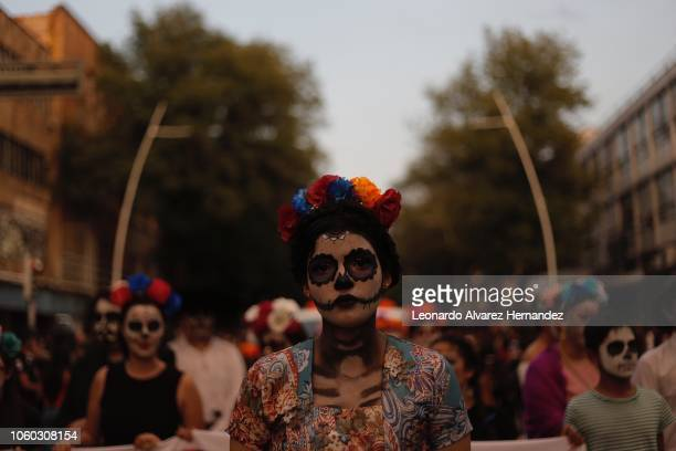 A women dressed as a Catrina walks during a parade in the streets of Guadalajara prior the Day of the Dead celebratios on October 27 2017 in...