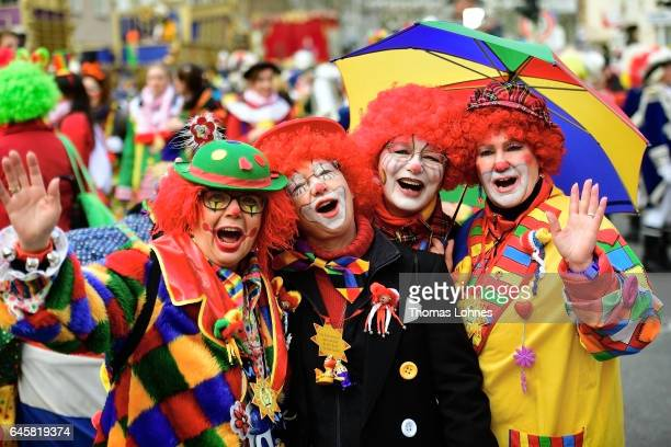 Women dressed as clowns celebrate the annual Rose Monday parade on February 27 2017 in Mainz Germany Political satire is a traditional cornerstone of...