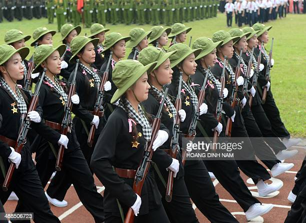 Women dressed as female Vietcong soldiers during the Vietnam war parade during official celebrations of the 60th anniversary of Vietnam's Dien Bien...
