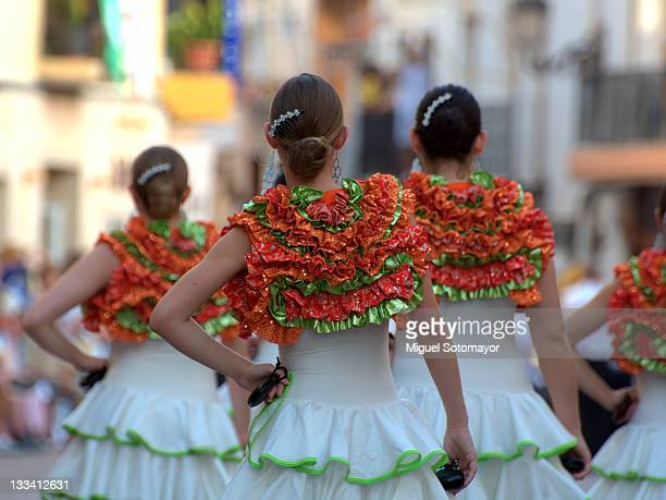 "women dressed as ""flamencas"" in parade - flamenco dancing stock photos and pictures"