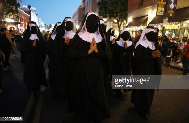 Women dressed as nuns walk while promoting the film 'The Nun' outside San Diego ComicCon on July 19 2018 in San Diego California Thousands of...