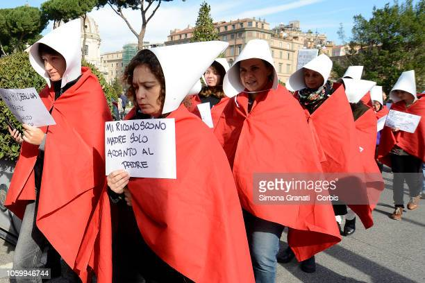 100 women dressed as silent maid servants crossed the city center during the protest against the decree law called ddl Pillon proposed by the Senator...