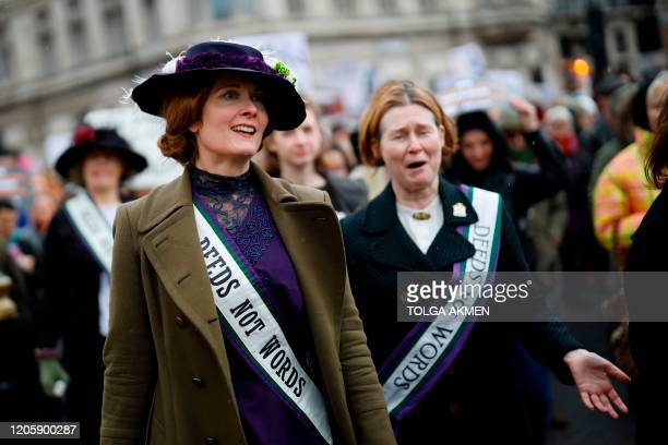 "Women dressed as suffragettes attend the ""March4Women"" during the International Women's Day in London on March 8, 2020. - Many feminist groups held..."