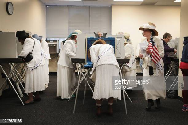 Women dressed as suffragettes cast ballots for the midterm elections at the Polk County Election Office on October 8 2018 in Des Moines IowaToday was...
