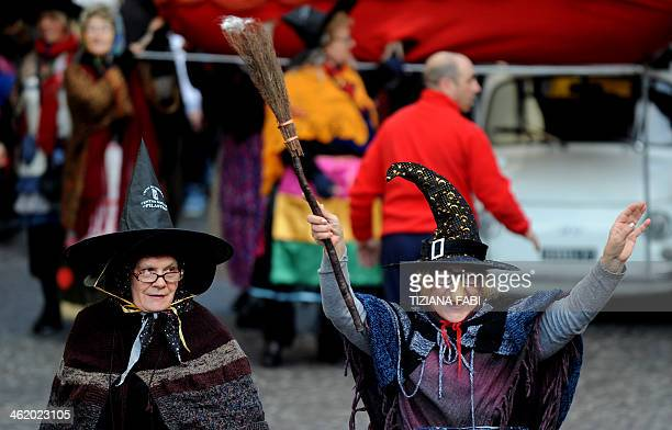 Women dressed as the witch Befana carry a 54metre long stocking during the annual Befana procession in Viterbo on January 12 2014 AFP PHOTO / TIZIANA...