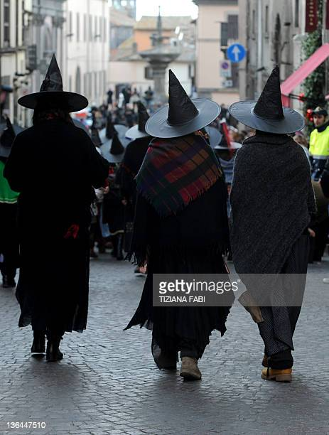 Women dressed as the witch Befana parade as 100 other Befanas carry a 52metre long stocking full of presents during the annual Befana procession in...