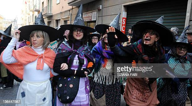 Women dressed as the witch Befana parade while 100 others carry a 52metre long stocking full of presents during the annual Befana procession in...