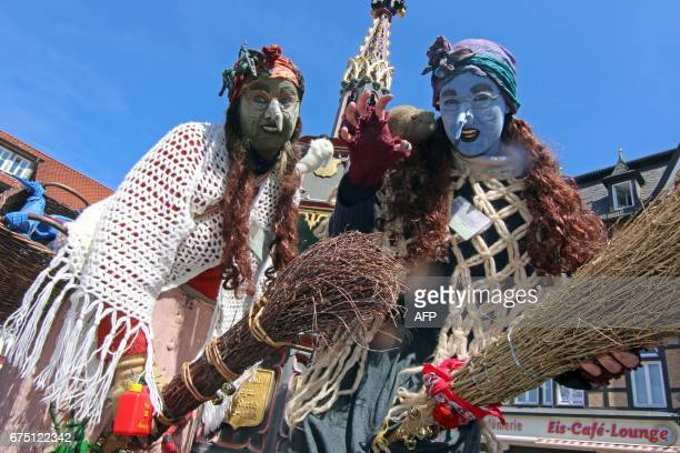 Women dressed as witches pose on the market square of Wernigerode central Germany on April 30 as they celebrate the socalled Walpurgis Night or...