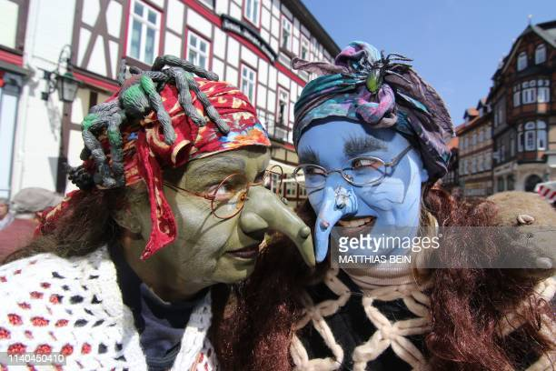 Women dressed as witches take part in an event to celebrate Walpurgis Night in Wernigerode central Germany at the foot of the Brocken mountain in the...