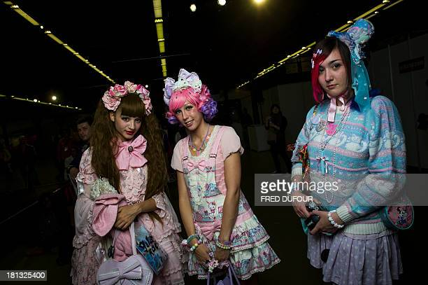 Women dressed in a Kawaii style pose at the Tokyo Crazy Kawaii Paris Fair on September 20 2013 in Paris AFP PHOTO / FRED DUFOUR