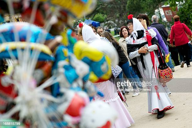 Women dressed in chulapo traditional clothing of the San Isidro look on during the festivities on May 15 2013 in Madrid Spain