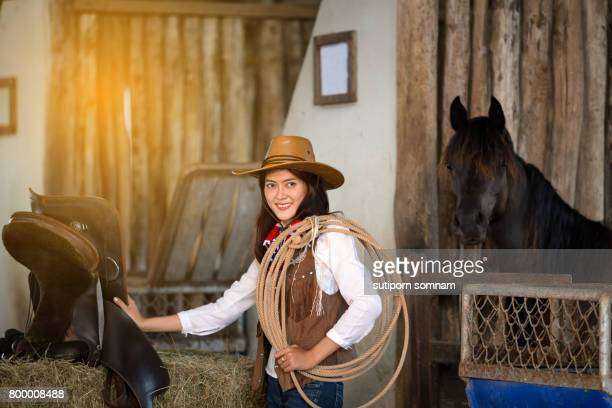 Women dressed in cowboy costumes working