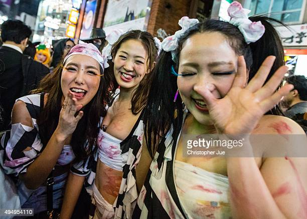 Women dressed in Halloween costumes gather in Tokyo's Shibuya district on October 30 2015 in Tokyo Japan Tokyo metropolitan police is expected to...