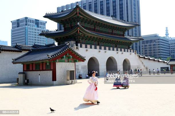 Women dressed in Hanbok traditional South Korean dress walk through Gyeongbokgung Palace on May 18 2017 in Seoul South Korea The FIFA U20 World Cup...