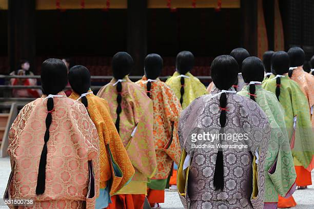 Women dressed in Heian Period costumes walk in the procession of the Aoi Festival at Shimogamo Shrine on May 15 2016 in Kyoto Kyoto Aoi Festival is...