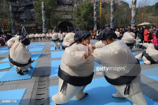Women dressed in inflatable sumowrestler costumes warm up in a wrestling contest at Songcheng Scenic Spot on March 7 2017 in Hangzhou Zhejiang...