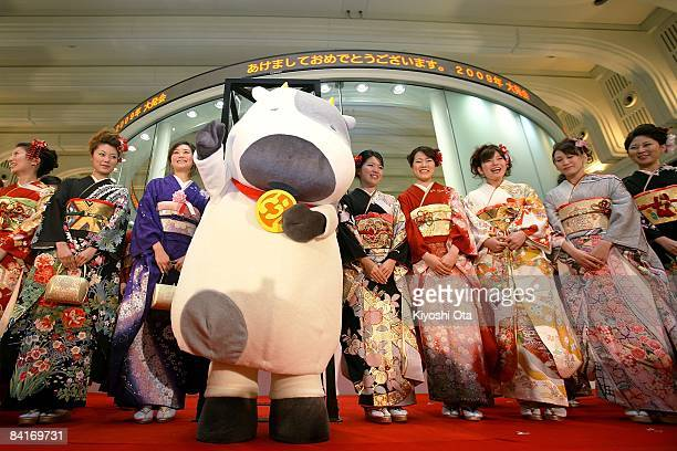 Women dressed in kimonos and a man in costume characterizing the 'Year of the Ox' pose as they attend the opening ceremony to celebrate the start of...