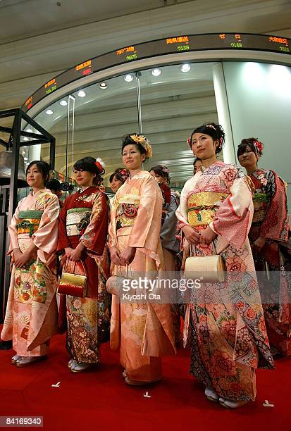 Women dressed in kimonos attend the opening ceremony to celebrate the start of the year's trading at the Tokyo Stock Exchange on January 5 2009 in...