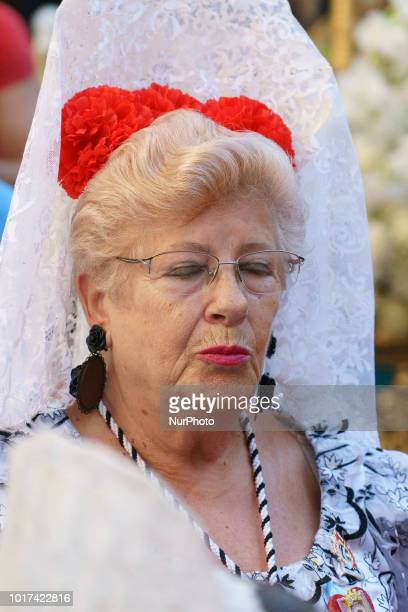 Women dressed in Madrid's traditional attire 'Chulapos' attend the Feast of La Paloma Virgin in Madrid spain on August 15 2018 Madrid's history and...