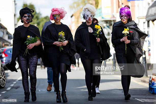 Women dressed in mask take part in the Shakespeare Birthday Celebration Parade on April 23 2016 in StratforduponAvon England This year the...