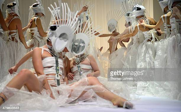 Women dressed in Moroccan costumes reacts during a performance at the opening of 'The Divine Comedy Heaven Hell and Purgatory From The Perspective Of...