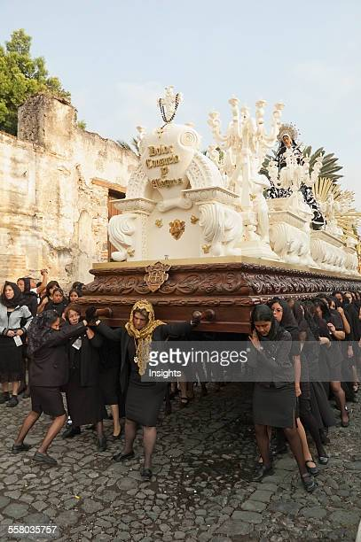 Women Dressed In Mourning Carry The Anda Of The Sorrowful Virgin Mary During The Holy Burial Procession On Good Friday In Antigua Guatemala Sacatep