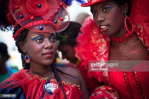 Women dressed in party attire prepare to participate in a parade during carnival weekend in Jacmel Haiti February 27 2011 This year's celebration was...