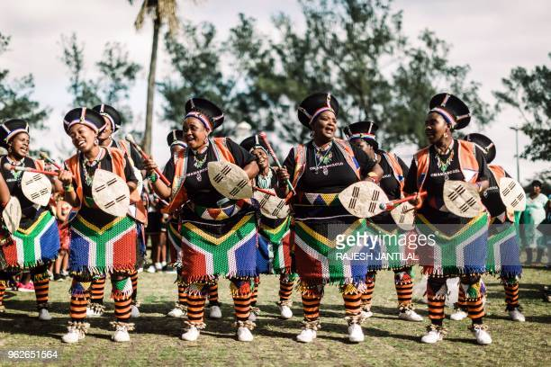 Women dressed in traditional attire sing and chant in Durban as they take part on May 26 2018 in a street carnival festival celebrating Africa Month...