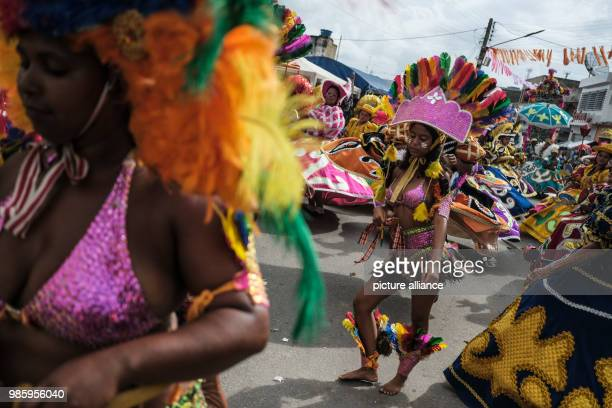 Women dressed in traditional carnival costume taking part in a carnival parade in Nazare de Mata Brazil 13 February 2018 Nazare de mata is a small...