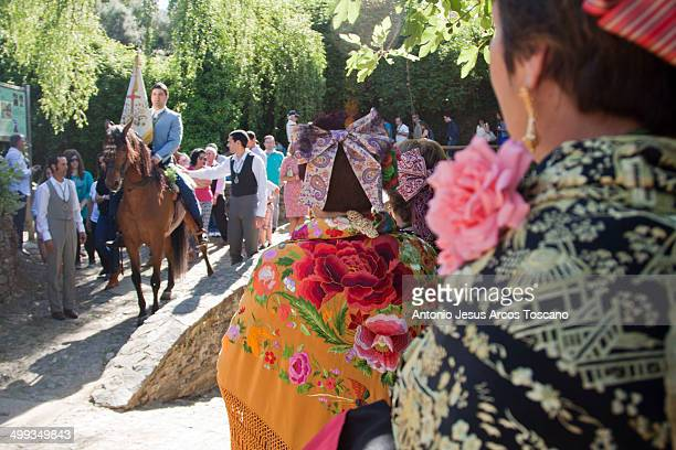 Women dressed in traditional embroidered shawls and ties, waiting at the entrance of the village, the arrival of the Mozo on horseback, carrying the...