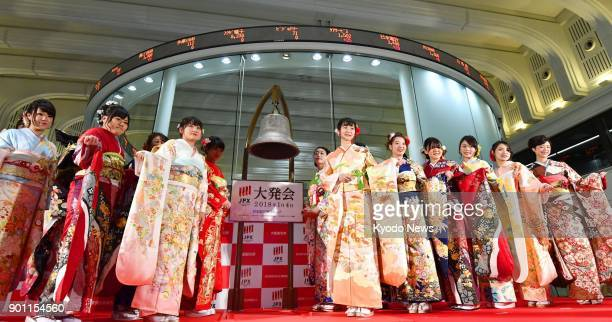 Women dressed in traditional Japanese kimono attend a ceremony for the year's first trading day at the Tokyo Stock Exchange in Tokyo on Jan 4 2018...
