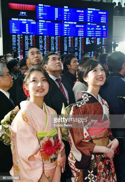 Women dressed in traditional Japanese kimono look at a stock price board at the Tokyo Stock Exchange on Jan 4 the first trading day of the year...