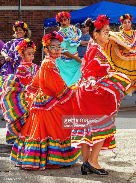 Women dressed in traditional La Calavera Catrina costumes dance the Larabe Tapatio during the Day of the Dead event held in downtown today Emporia...