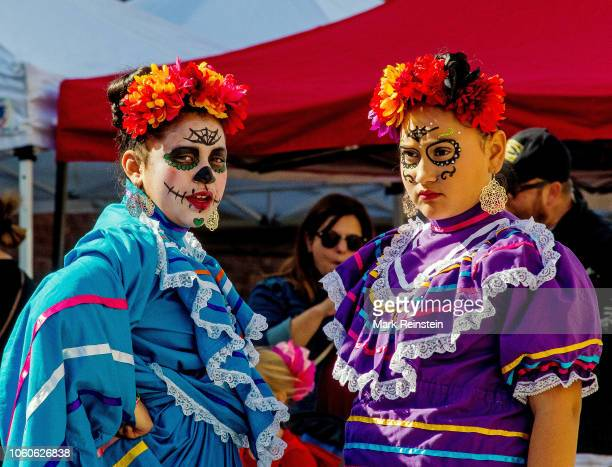 Women dressed in traditional La Calavera Catrina costumes during the Day of the Dead event held in downtown Emporia Kansas October 27 2018