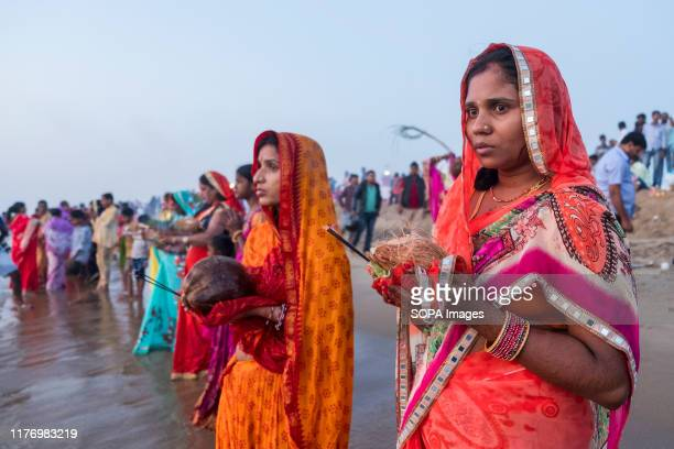 Women dressed in traditional saree at the marina beach during the festival Chhath Puja is one of the vibrant and colorful festivals of India Mainly...