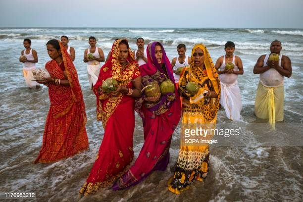 Women dressed in traditional saree worship during the festival at the marina beach Chhath Puja is one of the vibrant and colorful festivals of India...