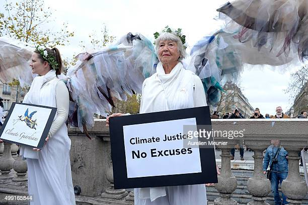Women dressed like angles holding signs during the forbidden COP21 demonstration at Place de la Republique on November 29, 2015 in Paris, France. The...