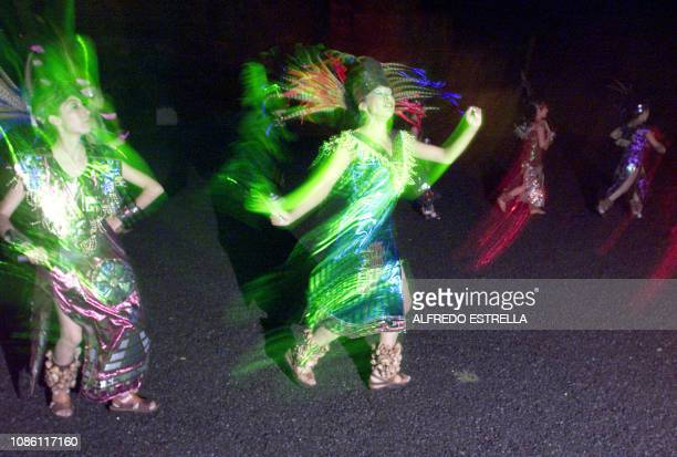 Women dressed like their Aztec forefathers dance during the ceremony of the Centroamerican fire which will preformed in El Salvador in the Central...