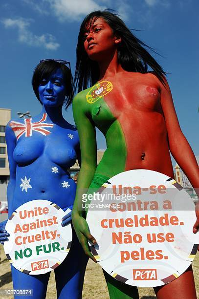 Women dressed only in knickers and body paint hold up placards and pose as they hold a People for the Ethical Treatment of Animals demonstration on...
